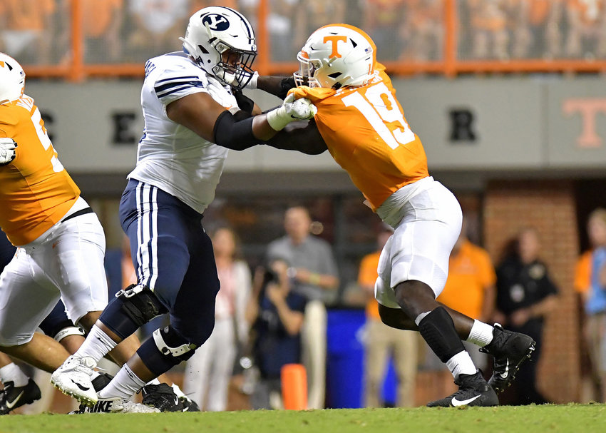 Tennessee Volunteers linebacker Darrell Taylor (19) battles a Brigham Young Cougars defensive lineman in the second half of an NCAA football game Saturday, Sept. 7, 2019, at Neyland Stadium in Knoxville, Tenn. BYU defeats UT 29-26 in double overtime.