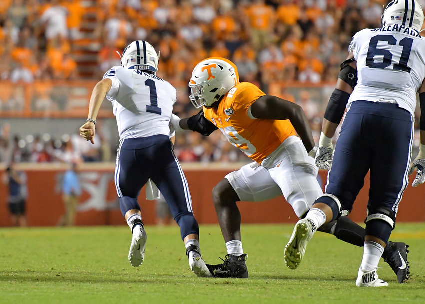 Brigham Young Cougars quarterback Zach Wilson (1) runs right up the middle late in the second half of an NCAA football game between the Cougars and the Tennessee Volunteers Saturday, Sept. 7, 2019, at Neyland Stadium in Knoxville, Tenn. BYU defeats UT 29-26 in double overtime.