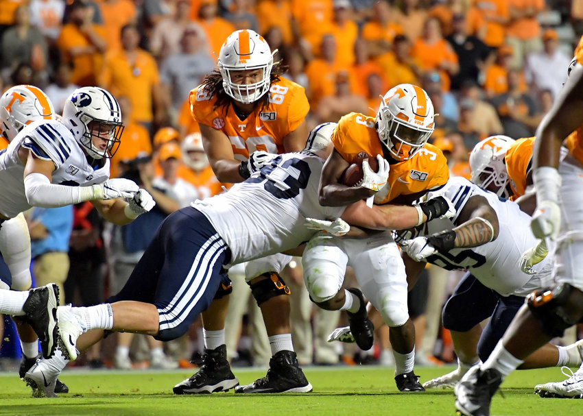 Tennessee Volunteers running back Eric Gray (3) is tackled after a few yards gain in the second half of an NCAA football game against the Brigham Young Cougars Saturday, Sept. 7, 2019, at Neyland Stadium in Knoxville, Tenn. BYU defeats UT 29-26 in double overtime.
