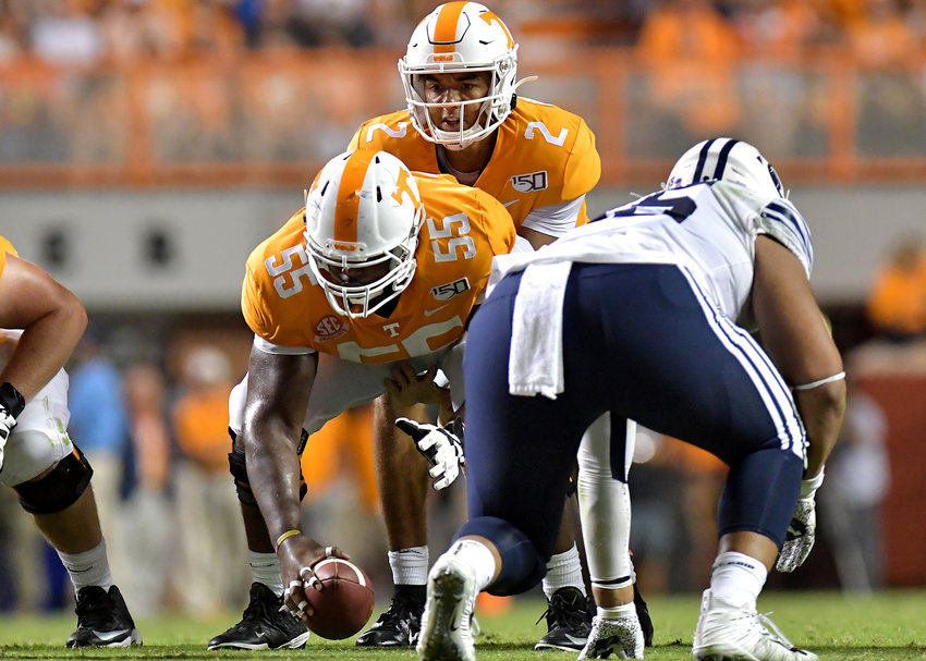 Tennessee Volunteers offensive lineman Brandon Kennedy (55) prepares to snap the ball to quarterback Jarrett Guarantano (2) in the second half of an NCAA football game Saturday, Sept. 7, 2019, at Neyland Stadium in Knoxville, Tenn. BYU defeats UT 29-26 in double overtime.
