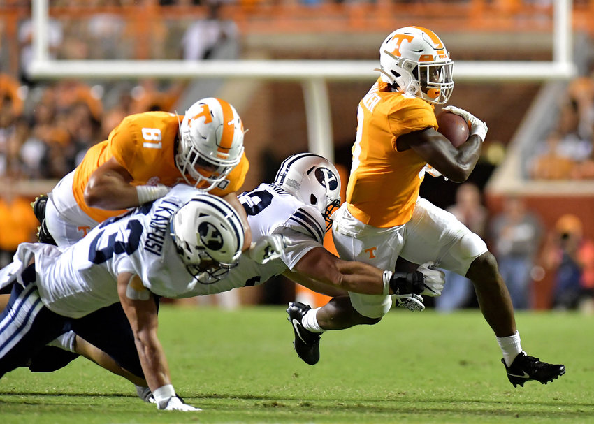 Tennessee Volunteers running back Ty Chandler (8) gets around the end in the second half of an NCAA football game against the Brigham Young Cougars Saturday, Sept. 7, 2019, at Neyland Stadium in Knoxville, Tenn. BYU defeats UT 29-26 in double overtime.
