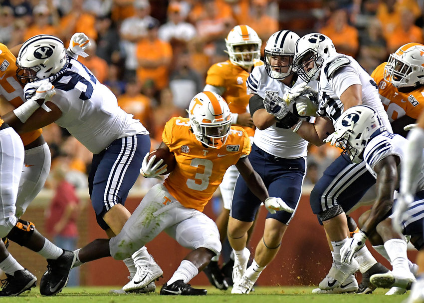 Tennessee Volunteers running back Eric Gray (3) finds a hole in the Brigham Young Cougars defensive line during the second half of an NCAA football game Saturday, Sept. 7, 2019, at Neyland Stadium in Knoxville, Tenn. BYU defeats UT 29-26 in double overtime.