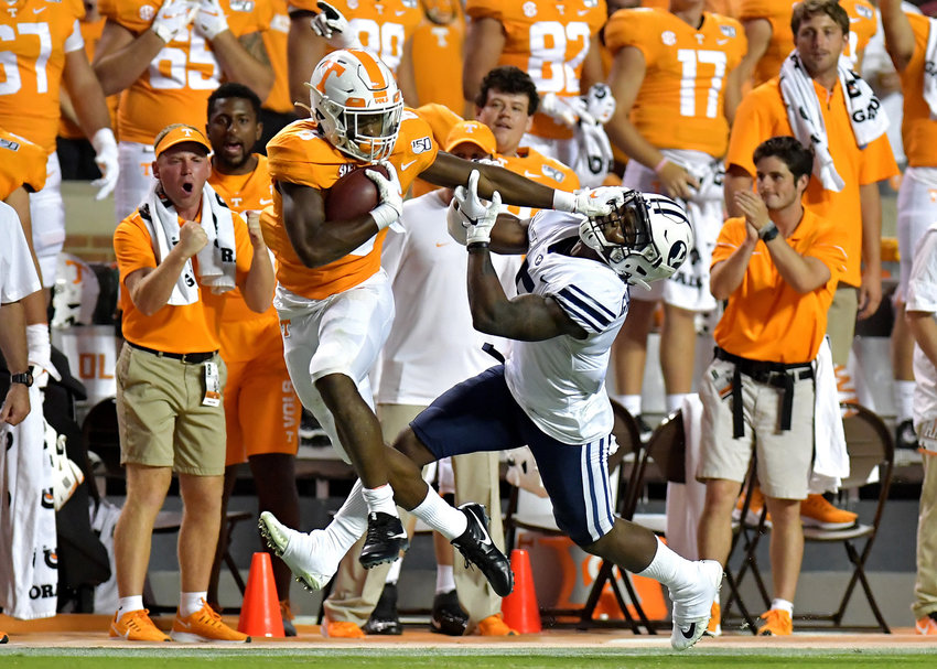 Tennessee Volunteers running back Ty Chandler (8) stiff-arms a Brigham Young Cougars defensive player while getting a first down late in the first half of an NCAA football game Saturday, Sept. 7, 2019, at Neyland Stadium in Knoxville, Tenn. BYU defeats UT 29-26 in double overtime.