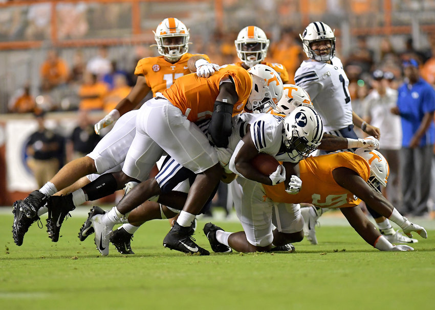 The Tennessee Volunteers defense swarms a Brigham Young Cougars player during the first half of an NCAA football game Saturday, Sept. 7, 2019, at Neyland Stadium in Knoxville, Tenn. BYU defeats UT 29-26 in double overtime.