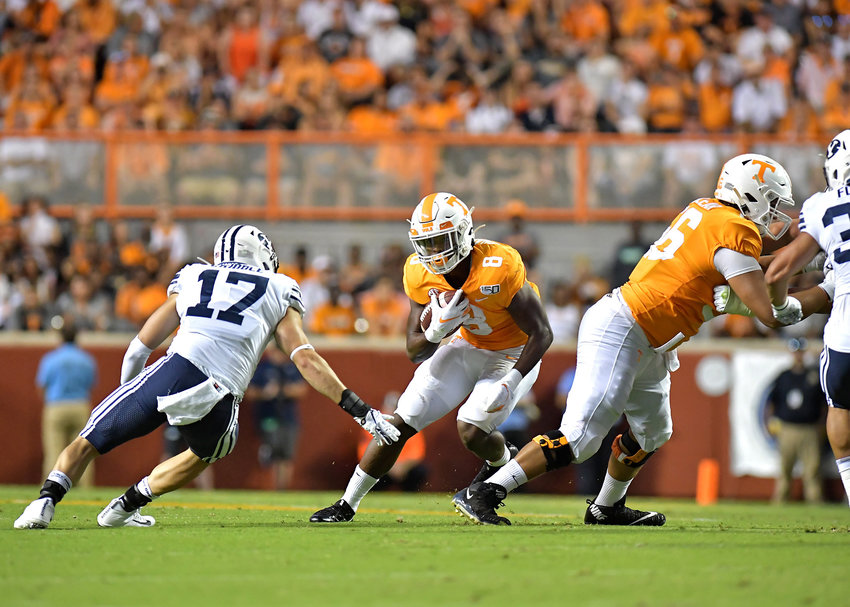 Tennessee Volunteers running back Ty Chandler (8) looks for room to get by Brigham Young Cougars linebacker Matthew Criddle (17) in the first half of an NCAA football game Saturday, Sept. 7, 2019, at Neyland Stadium in Knoxville, Tenn. BYU defeats UT 29-26 in double overtime.