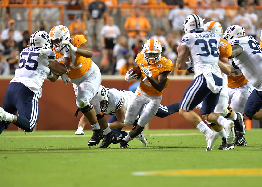 Tennessee Volunteers running back Eric Gray (3) finds a hole up the middle in the first half of an NCAA football game against the Brigham Young Cougars Saturday, Sept. 7, 2019, at Neyland Stadium in Knoxville, Tenn.  BYU defeats UT 29-26 in double overtime.