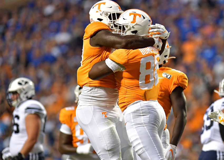 Tennessee Volunteers defensive players celebrate a stop in the first half of an NCAA football game against the Brigham Young Cougars Saturday, Sept. 7, 2019, at Neyland Stadium in Knoxville, Tenn. BYU defeats UT 29-26 in double overtime.
