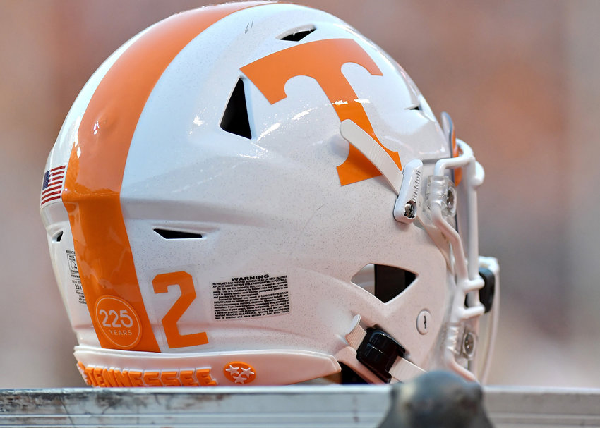 A Tennessee Volunteers football helmet, with its sticker on the back commemorating UT's 225th year, is pictured on an equipment box during the first half of an NCAA football game against the Brigham Young Cougars Saturday, Sept. 7, 2019, at Neyland Stadium in Knoxville, Tenn. BYU defeats UT 29-26 in double overtime.