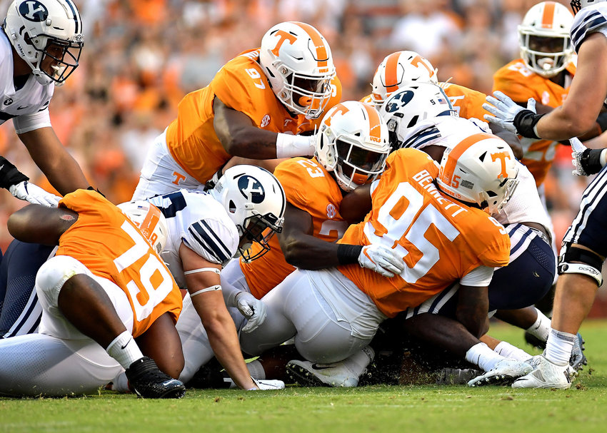 The Tennessee Volunteers defense, lead by linebacker Kivon Bennett (95), swarms a Brigham Young Cougars player at the line of scrimmage in the first half of an NCAA football game Saturday, Sept. 7, 2019, at Neyland Stadium in Knoxville, Tenn. BYU defeats UT 29-26 in double overtime.