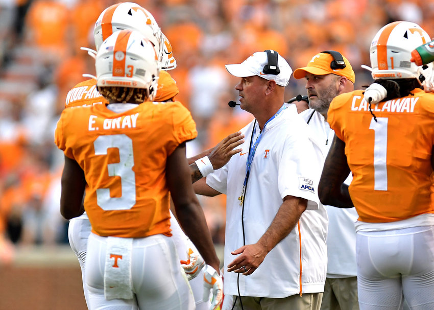 Tennessee Volunteers head coach Jeremy Pruitt talks to his players during a time out in the first half of an NCAA college football game against the Brigham Young Cougars Saturday, Sept. 7, 2019, at Neyland Stadium in Knoxville, Tenn. BYU defeats UT 29-26 in double overtime.
