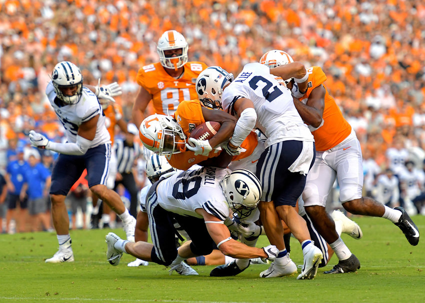 Tennessee Volunteers running back Eric Gray (3) is tackled in the first half of an NCAA football game against the Brigham Young Cougars Saturday, Sept. 7, 2019, at Neyland Stadium in Knoxville, Tenn. BYU defeats UT 29-26 in double overtime.