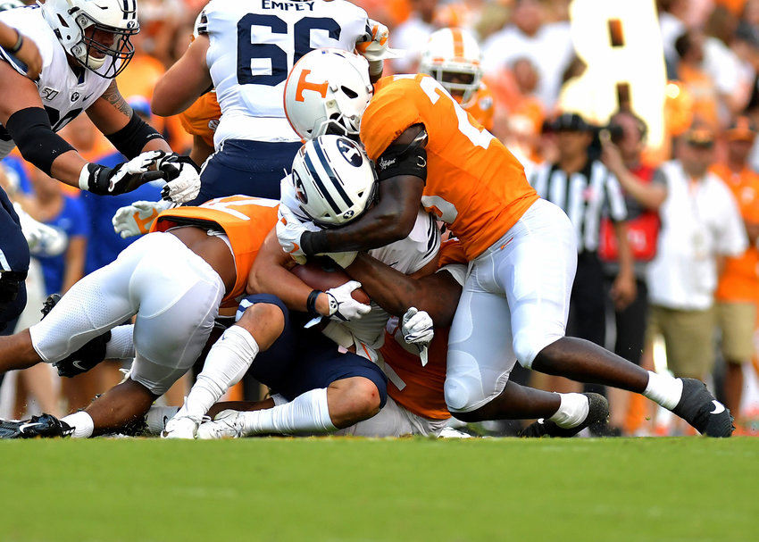 Brigham Young Cougars running back Lopini Katoa (4) is tackled at the line of scrimmage by Tennessee Volunteers linebacker Will Ignont (23) in the first quarter of the NCAA football game Saturday, Sept. 7, 2019, at Neyland Stadium in Knoxville, Tenn. BYU defeats UT 29-26 in double overtime.