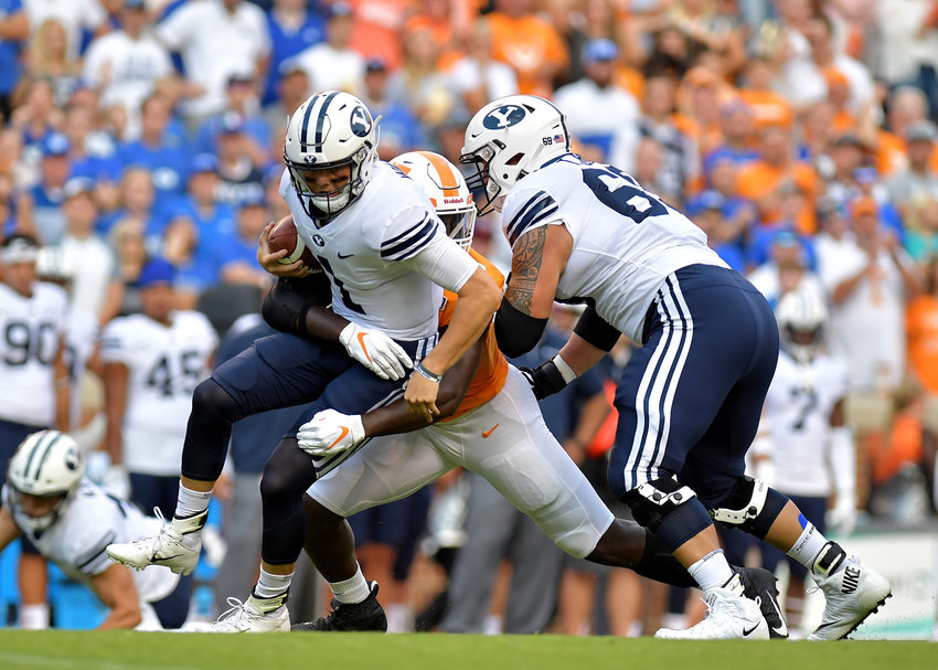 Tennessee Volunteers linebacker Darrell Taylor sacks Brigham Young Cougars quarterback Zach Wilson (1) early in the first quarter of an NCAA football game Saturday, Sept. 7, 2019, at Neyland Stadium in Knoxville, Tenn. BYU defeats UT 29-26 in double overtime.