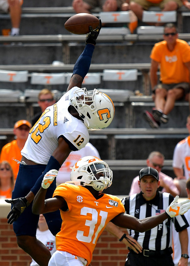 Chattanooga Mocs wide receiver Reginald Henderson (12) goes up for a one-handed catch that would be ruled out of bounds in the fourth quarter of an NCAA football game against the Tennessee Volunteers Saturday, Sept. 14, 2019, at Neyland Stadium in Knoxville Tenn. Tennessee defeats Chattanooga 45-0.