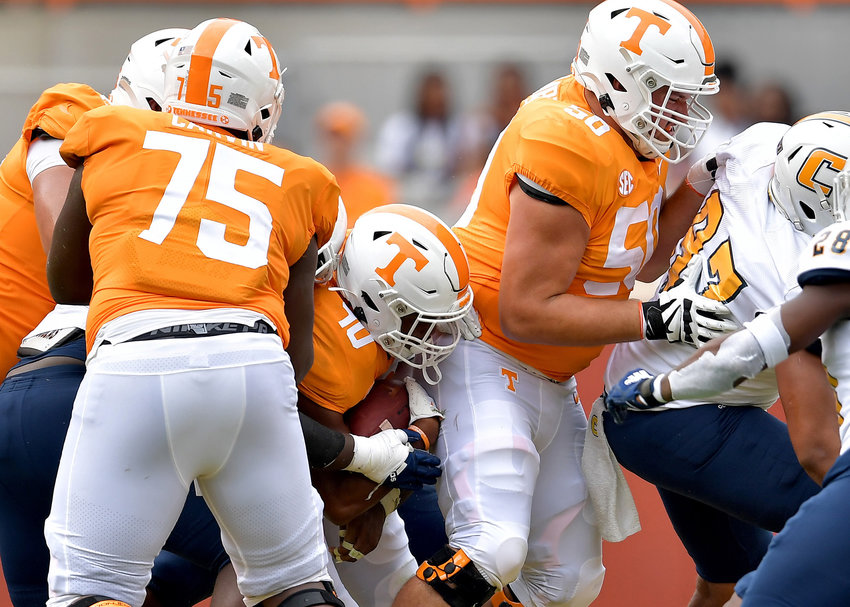 Tennessee Volunteers running back Fred Orr (40) tries to find room to run behind the blocking of offensive lineman Jackson Lampley (50) during the second half of an NCAA football game against the Chattanooga Mocs Saturday, Sept. 14, 2019, at Neyland Stadium in Knoxville Tenn. Tennessee defeats Chattanooga 45-0.
