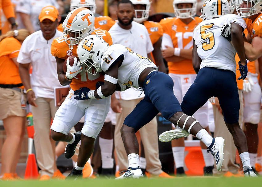 Chattanooga Mocs defensive back D.J. Jackson (21) tackled Tennessee Volunteers running back Fred Orr (40) during the fourth quarter of an NCAA football game Saturday, Sept. 14, 2019, at Neyland Stadium in Knoxville Tenn. Tennessee defeats Chattanooga 45-0.