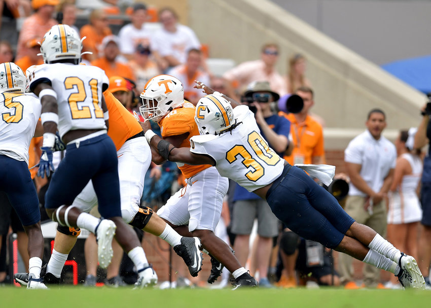 Chattanooga Mocs linebacker Jay Person (30) with a tackle during the fourth quarter of an NCAA football game against the Tennessee Volunteers Saturday, Sept. 14, 2019, at Neyland Stadium in Knoxville Tenn. Tennessee defeats Chattanooga 45-0.