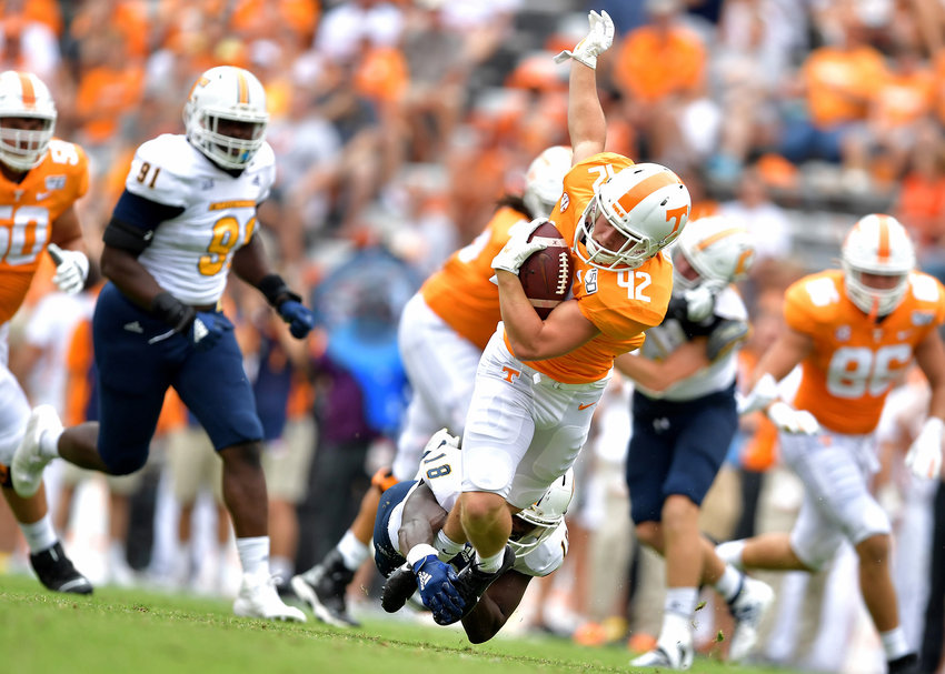 Tennessee Volunteers running back Chip Omer (42) is tackled after a big gain in the second half of an NCAA football game against the Chattanooga Mocs Saturday, Sept. 14, 2019, at Neyland Stadium in Knoxville Tenn. Tennessee defeats Chattanooga 45-0.