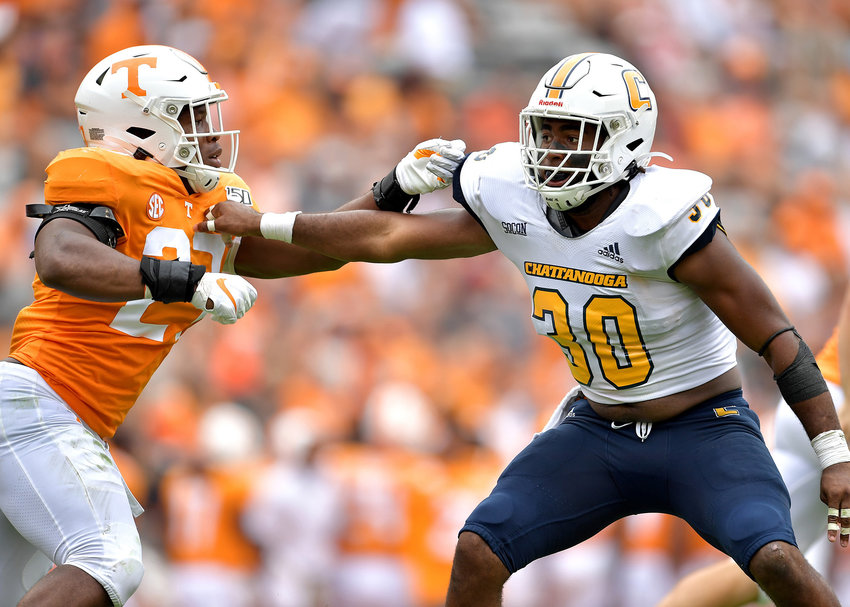 Chattanooga Mocs linebacker Jay Person (30) fends of a Tennessee Volunteers player while watching for a runner during the second half of an NCAA football game Saturday, Sept. 14, 2019, at Neyland Stadium in Knoxville Tenn. Tennessee defeats Chattanooga 45-0.