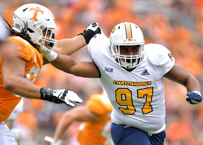 Chattanooga Mocs defensive lineman Tavi McLean (97) makes life hard for Tennessee Volunteers offensive lineman Marcus Tatum (68) in the third quarter of an NCAA football game Saturday, Sept. 14, 2019, at Neyland Stadium in Knoxville Tenn. Tennessee defeats Chattanooga 45-0.