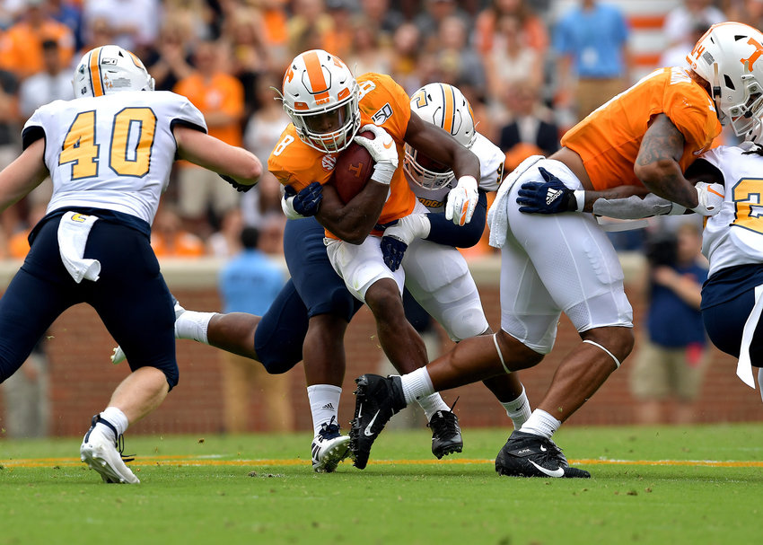 Tennessee Volunteers running back Ty Chandler (8) looks for room to run during the first half of the NCAA football game against the Chattanooga Mocs Saturday, Sept. 14, 2019, at Neyland Stadium in Knoxville Tenn. Tennessee shuts out Chattanooga 45-0.