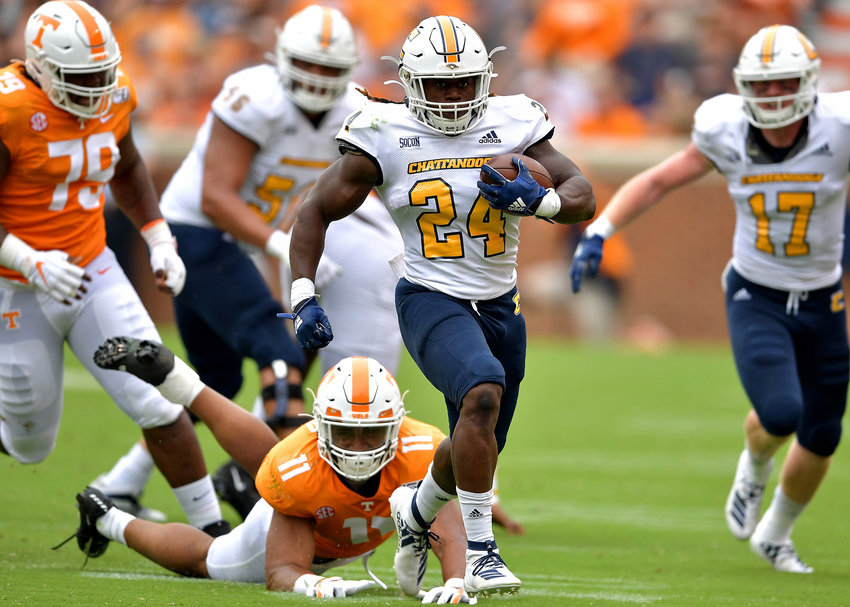 Chattanooga Mocs running back Elijah Ibitokun-Hanks (24) with a big run up the middle for a first down in the first half of the NCAA football game against the Tennessee Volunteers Saturday, Sept. 14, 2019, at Neyland Stadium in Knoxville Tenn. Tennessee shuts out Chattanooga 45-0.