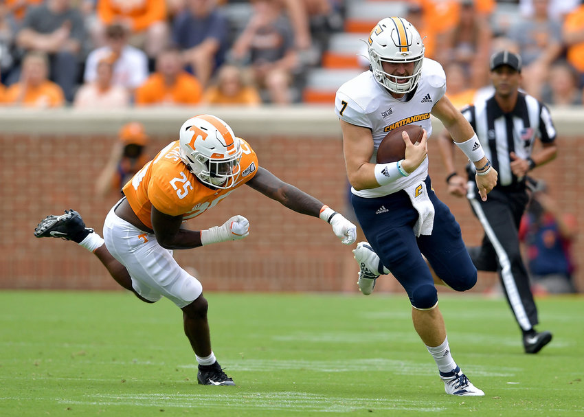 Chattanooga Mocs quarterback Nick Tiano (7) with a keeper for a first down in the first half of the NCAA football game between the Mocs and the Tennessee Volunteers Saturday, Sept. 14, 2019, at Neyland Stadium in Knoxville Tenn. Tennessee shuts out Chattanooga 45-0.