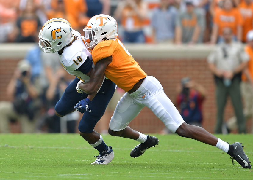 Chattanooga Mocs wide receiver Lameric Tucker (10) has a pass broken up in the first half of the NCAA football game against the Tennessee Volunteers Saturday, Sept. 14, 2019, at Neyland Stadium in Knoxville Tenn. Tennessee shuts out Chattanooga 45-0.