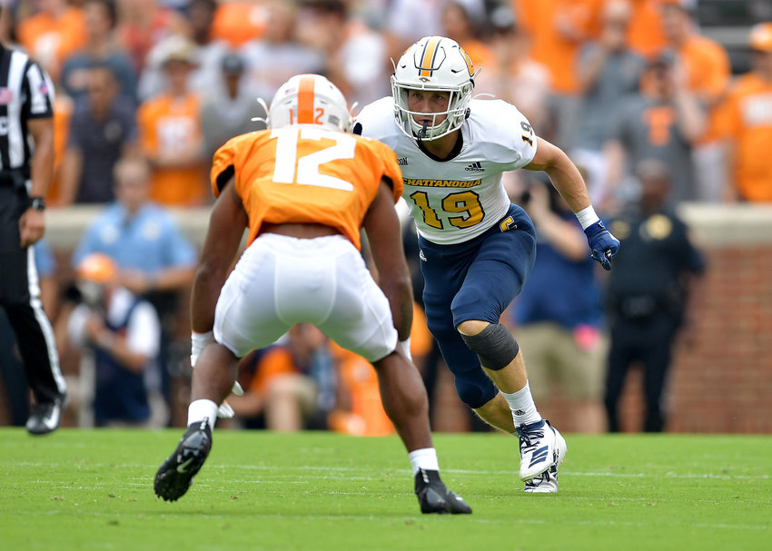 Chattanooga Mocs wide receiver Bryce Nunnelly (19) engages Tennessee Volunteers defensive back Shawn Shamburger (12) in the first quarter of the NCAA football game Saturday, Sept. 14, 2019, at Neyland Stadium in Knoxville Tenn. Tennessee shuts out Chattanooga 45-0.