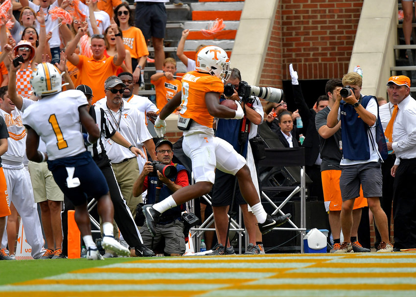 Tennessee Volunteers running back Ty Chandler (8) scores a touchdown in the first quarter of the NCAA football game against the Chattanooga Mocs Saturday, Sept. 14, 2019, at Neyland Stadium in Knoxville Tenn. Tennessee shuts out Chattanooga 45-0.