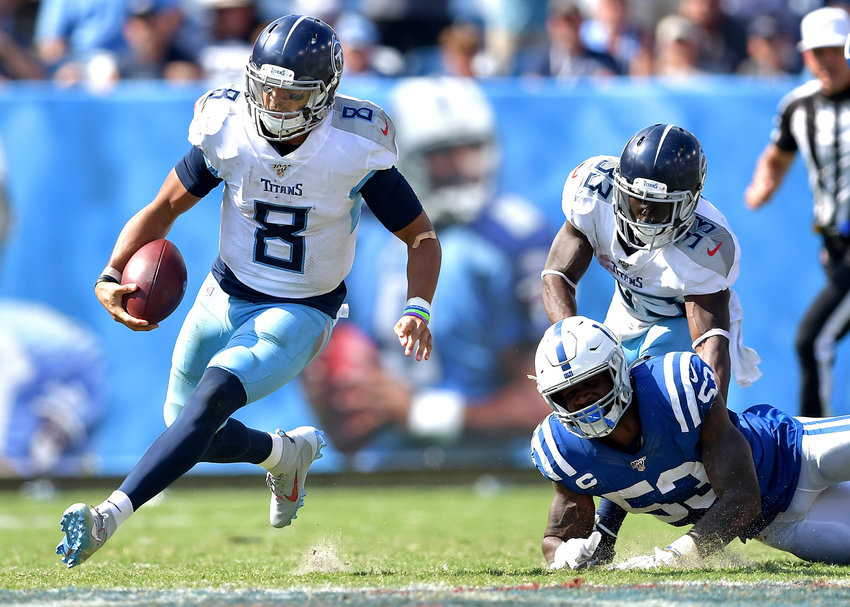 Tennessee Titans quarterback Marcus Mariota (8) loses a Colts defender during the second half of an NFL game between the Titans and the Indianapolis Colts Sept. 15, 2019, at Nissan Stadium in Nashville, Tenn. The Colts beat the Titans 19-17.