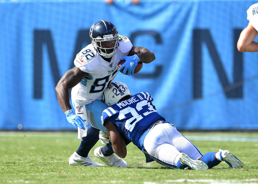 Tennessee Titans tight end Delanie Walker (82) turns up field and is tackled after a reception during the fourth quarter of an NFL game between the Titans and the Indianapolis Colts Sept. 15, 2019, at Nissan Stadium in Nashville, Tenn. The Colts beat the Titans 19-17.