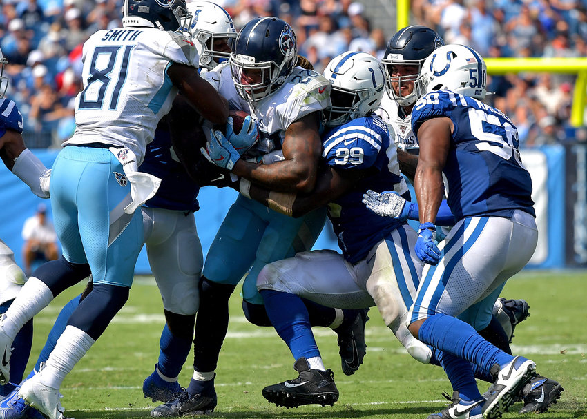 Tennessee Titans running back Derrick Henry (22) is tackled while trying to go up the middle in the second half of an NFL game between the Titans and the Indianapolis Colts Sept. 15, 2019, at Nissan Stadium in Nashville, Tenn. The Colts beat the Titans 19-17.
