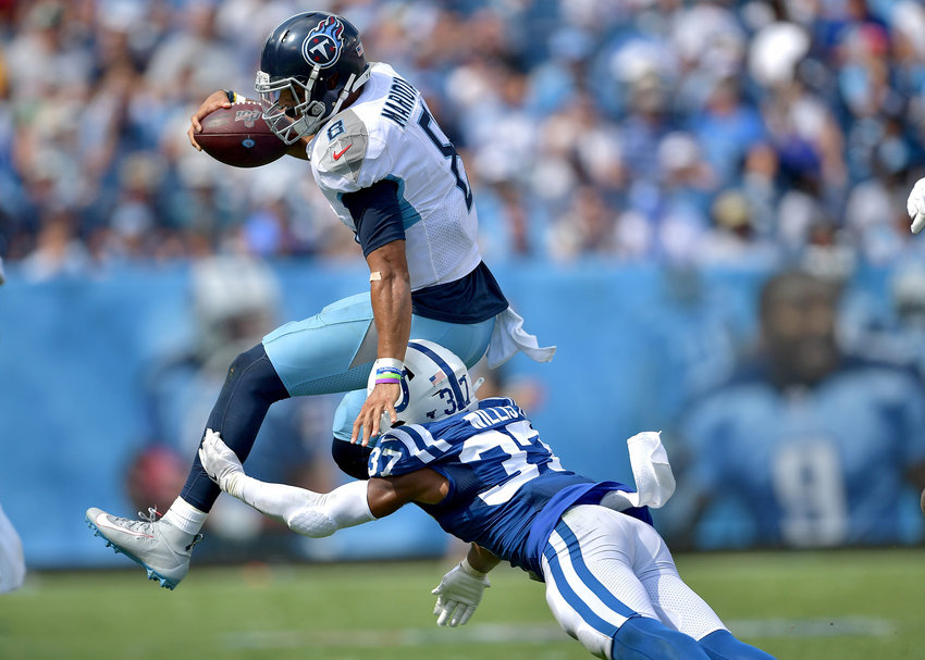 Tennessee Titans quarterback Marcus Mariota (8) leaps to avoid a tackle by Indianapolis Colts safety Khari Willis (37) in the second half of an NFL game Sept. 15, 2019, at Nissan Stadium in Nashville, Tenn. The Colts beat the Titans 19-17.