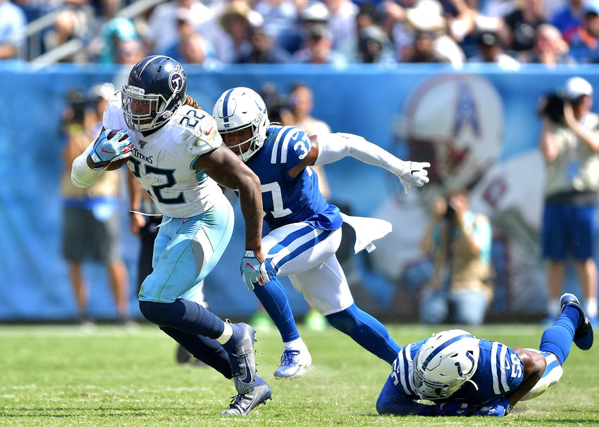 Tennessee Titans running back Derrick Henry (22) on his way to another first down during the second half of an NFL game between the Titans and the Indianapolis Colts Sept. 15, 2019, at Nissan Stadium in Nashville, Tenn. The Colts beat the Titans 19-17.