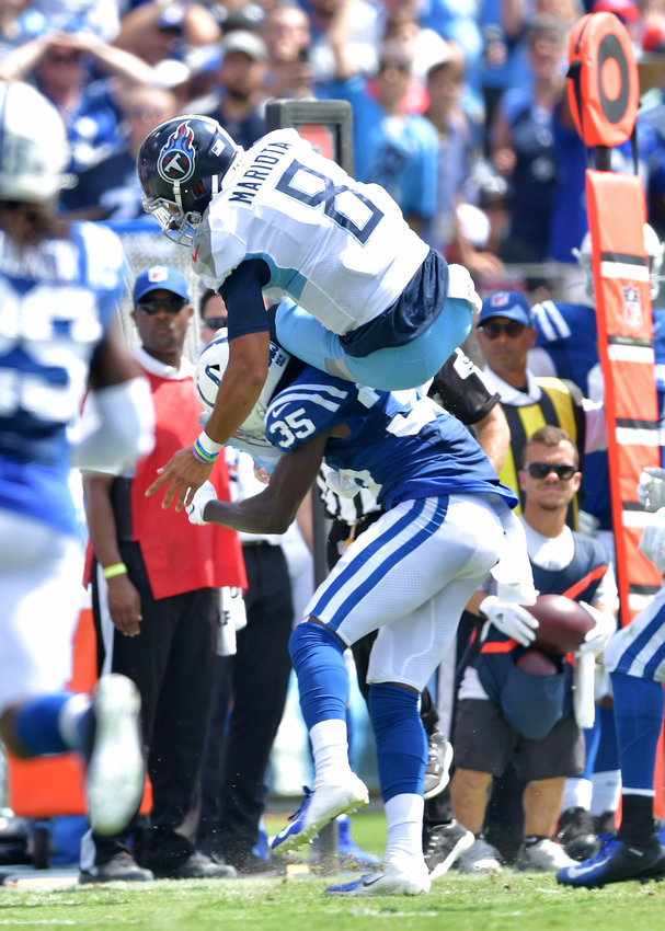 Tennessee Titans quarterback Marcus Mariota (8) attemps to leap a Colts defender during the first half of an NFL game between the Tennessee Titans and the Indianapolis Colts Sept. 15, 2019, at Nissan Stadium in Nashville, Tenn. The Colts beat the Titans 19-17.
