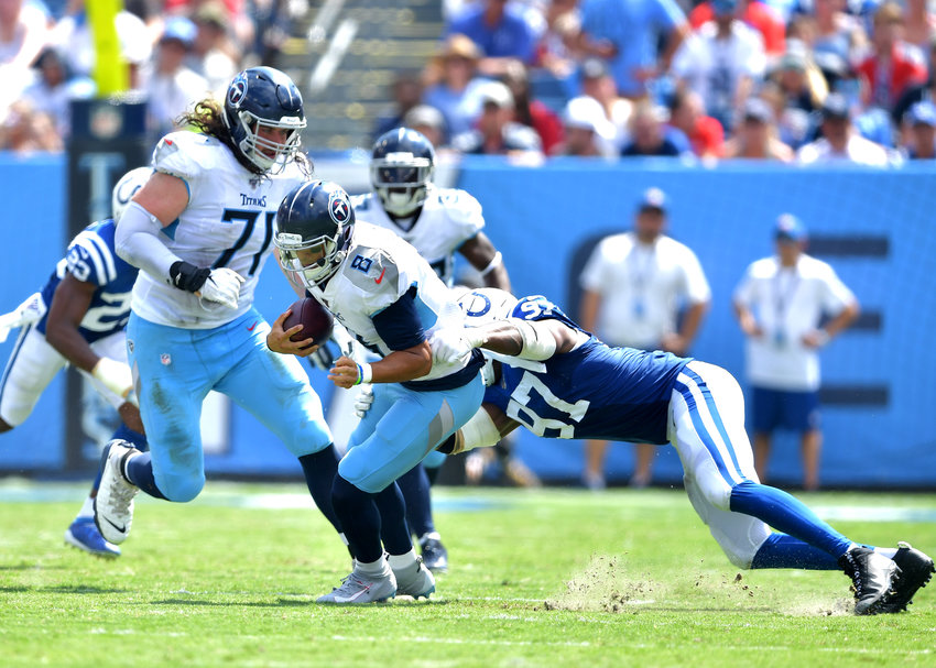 Tennessee Titans quarterback Marcus Mariota (8) scrambles under pressure during the first half of an NFL game between the Tennessee Titans and the Indianapolis Colts Sept. 15, 2019, at Nissan Stadium in Nashville, Tenn. The Colts beat the Titans 19-17.