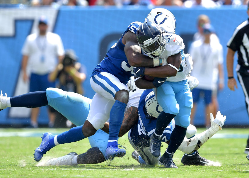 Tennessee Titans running back Dion Lewis (33) is tackled by Indianapolis Colts outside linebacker Darius Leonard (53) in the first half of an NFL game Sept. 15, 2019, at Nissan Stadium in Nashville, Tenn. The Colts beat the Titans 19-17.