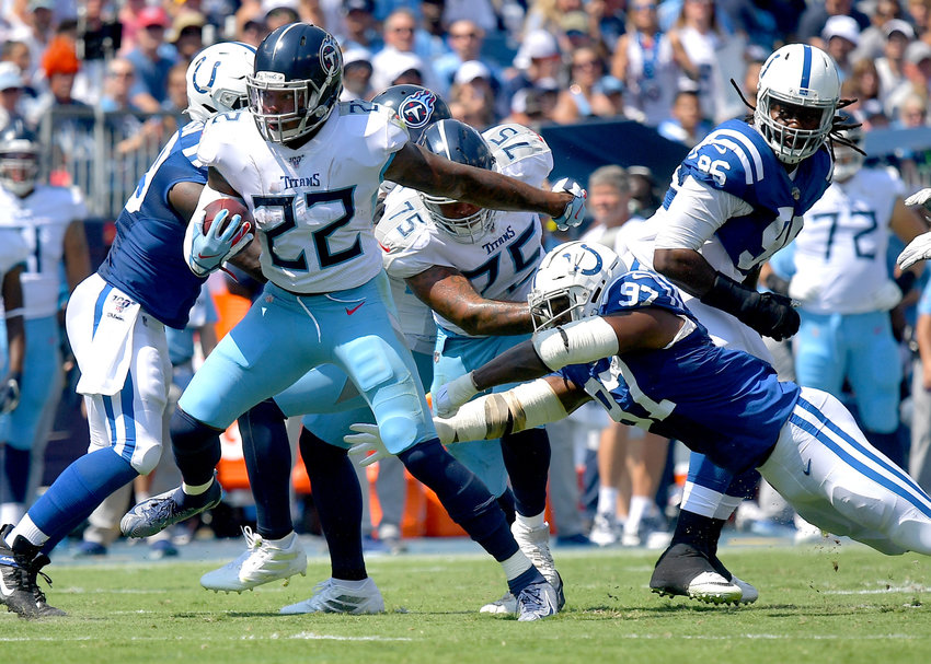 Tennessee Titans running back Derrick Henry (22) gets past defenders on his way to a first down in the first half of an NFL game between the Titans and the Indianapolis Colts Sept. 15, 2019, at Nissan Stadium in Nashville, Tenn. The Colts beat the Titans 19-17.