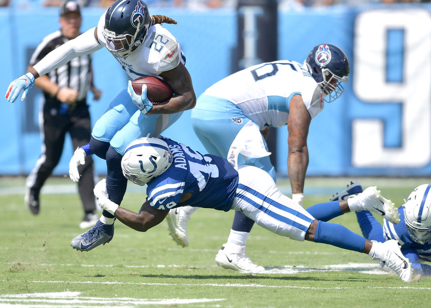 Tennessee Titans running back Derrick Henry (22) avoids a tackle on his way to a first down during the first half of an NFL game between the Titans and the Indianapolis Colts Sept. 15, 2019, at Nissan Stadium in Nashville, Tenn. The Colts beat the Titans 19-17.