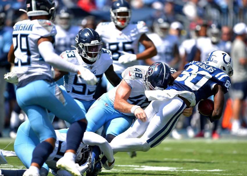 Tennessee Titans Beau Brinkley (48) tackles Indianapolis Colts wide receiver Chester Rogers (80) in the first half of an NFL game Sept. 15, 2019, at Nissan Stadium in Nashville, Tenn. The Colts beat the Titans 19-17.