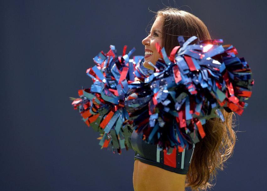 A Tennessee Titans cheerleader performs during the first half of an NFL game between the Titans and the Indianapolis Colts Sept. 15, 2019, at Nissan Stadium in Nashville, Tenn. The Colts beat the Titans 19-17.