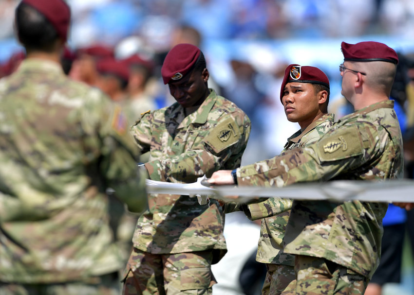 Soldiers from Ft. Campbell, Ken., hold the flag across the field during the national anthem prior to the start of an NFL game between the Tennessee Titans and the Indianapolis Colts Sept. 15, 2019, at Nissan Stadium in Nashville, Tenn.