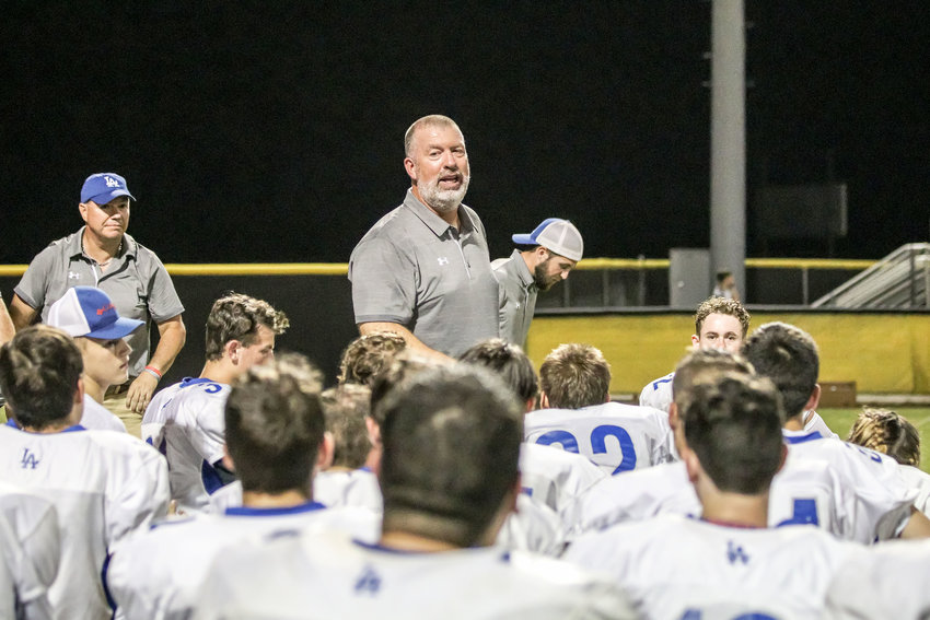 Livingston Academy coach Bruce Lamb talks to his team after the win over Upperman.