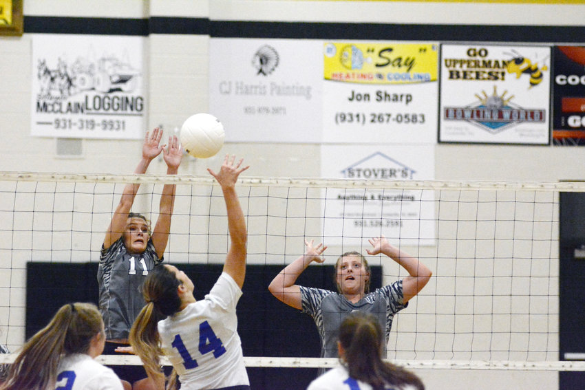 Upperman's Courtney Clouse (11) goes up to try and block at Macon County hitter during action Monday night.
