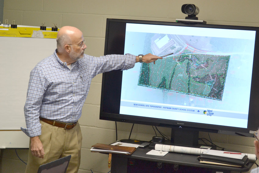 Kim Chamberlin of Upland Design Group goes over a map of the site for a new school in southwest Cookeville.