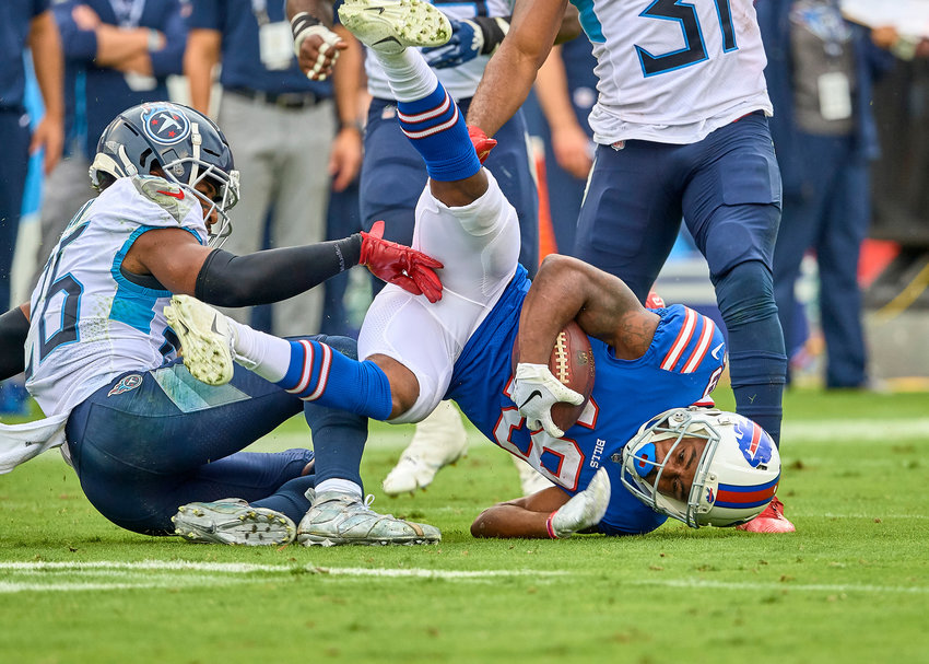 Buffalo Bills wide receiver Isaiah McKenzie (19) is tackled by Tennessee Titans cornerback Logan Ryan (26) during the second half of an NFL game Sunday, Oct. 6, 2019, at Nissan Stadium in Nashville, Tenn.