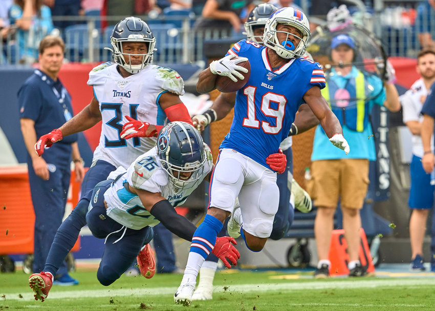 Buffalo Bills wide receiver Isaiah McKenzie (19) makes the catch and turns up field while Tennessee Titans cornerback Logan Ryan (26) tries to tackle him during the second half of an NFL game Sunday, Oct. 6, 2019, at Nissan Stadium in Nashville, Tenn.