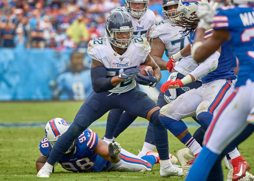 Tennessee Titans running back Derrick Henry (22) looks for an opening up the middle in the second half of an NFL game against the Buffalo Bills Sunday, Oct. 6, 2019, at Nissan Stadium in Nashville, Tenn.
