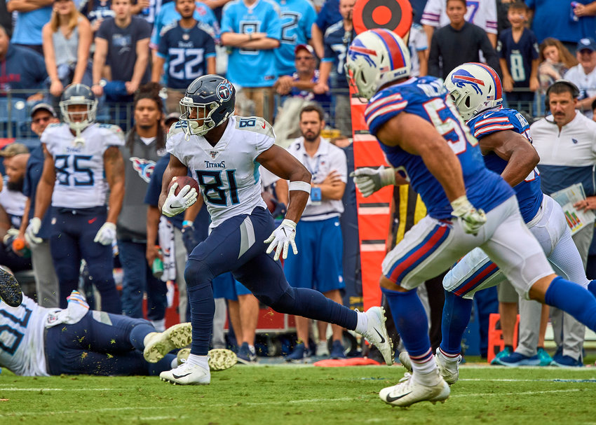 Tennessee Titans tight end Jonnu Smith (81) adds yards after the reception in the second half of an NFL game between the Buffalo Bills and the Titans Sunday, Oct. 6, 2019, at Nissan Stadium in Nashville, Tenn.